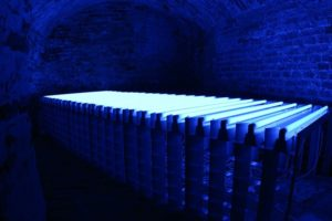 blue bed, fluorescent lamps and metal, stadtmusem neuoetting, germany, 2002